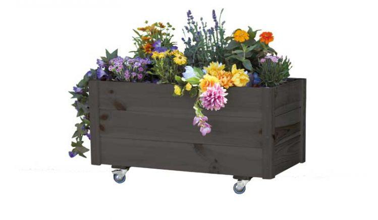 Der Blumenkasten Wittenberge besteht aus lasiertem Kiefernholz und wird teilmontiert im Karton inklusive Pflanzfolie geliefert