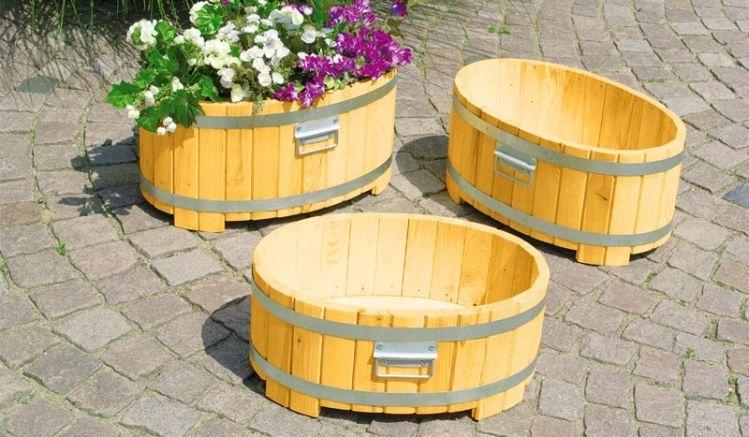 Runder Pflanzkübel aus tauchimprägniertem Kiefer- und Fichtenholz, erhältlich in der Größe 57 x 36 x 28 cm.