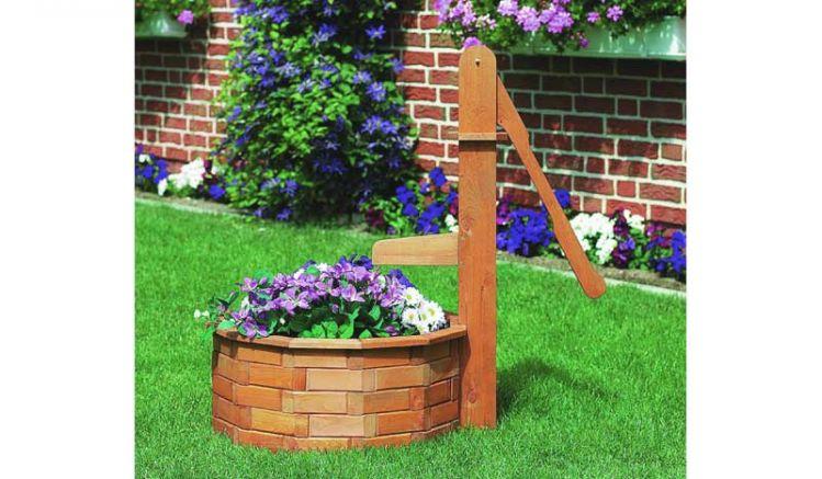 Die Wasserpumpe Holz Pensa aus honigbrauner Kiefer / Fichte mit dem Maß 70 x 65 x 100 cm. Das Holz ist FSC zertifiziert.